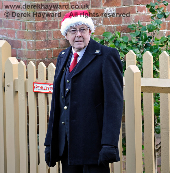 Station Master Mike Jackson improperly dressed at Kingscote.  13.12.2014 10215
