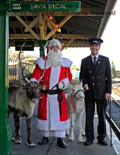 A smiling Fraser and Santa with two guests at Kingscote.  This was just before we told Fraser that he had to lead the reindeer over to platform 2... The rest I shall leave to your imagination. 13.12.2014 10161