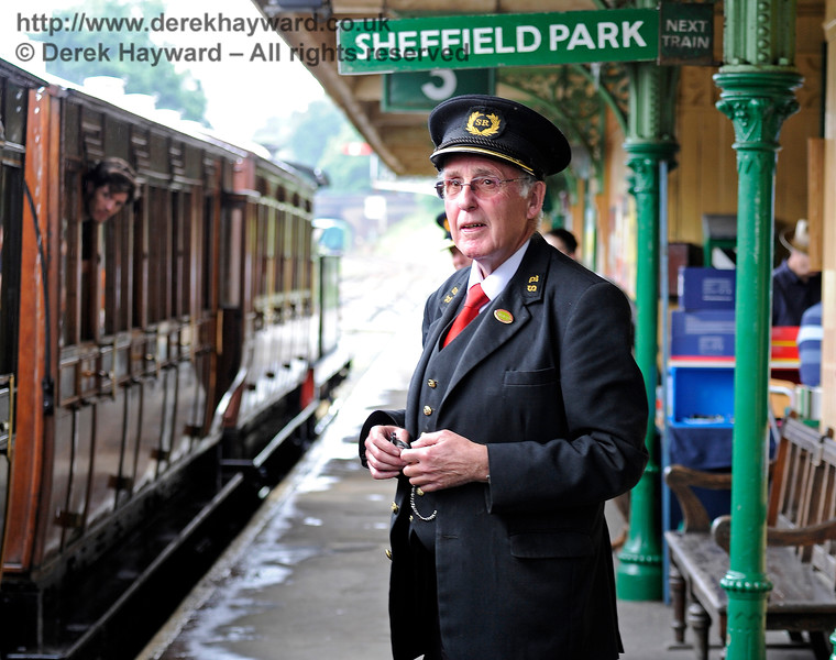 Horsted Keynes Station Master John Woods, pictured just before he realised that the train was actually going to East Grinstead.  It's easily done...  25.06.2016 13431