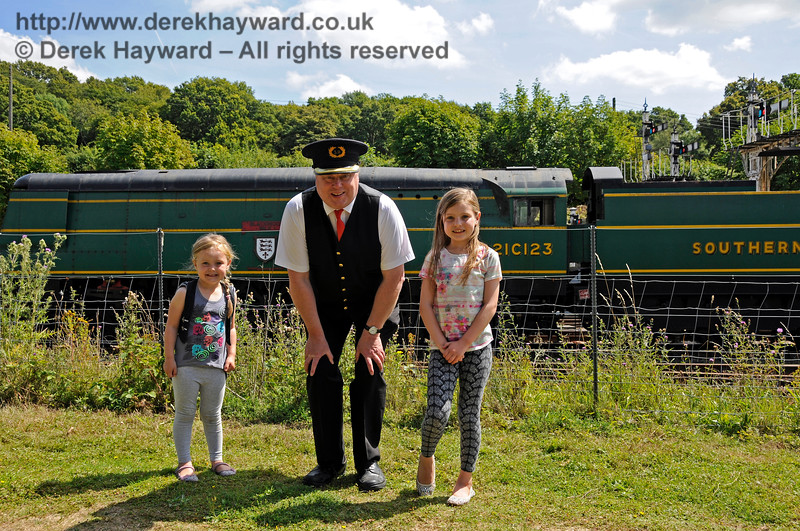 Tim Baker with two of our younger customers at Horsted Keynes.  01.08.2015 13354