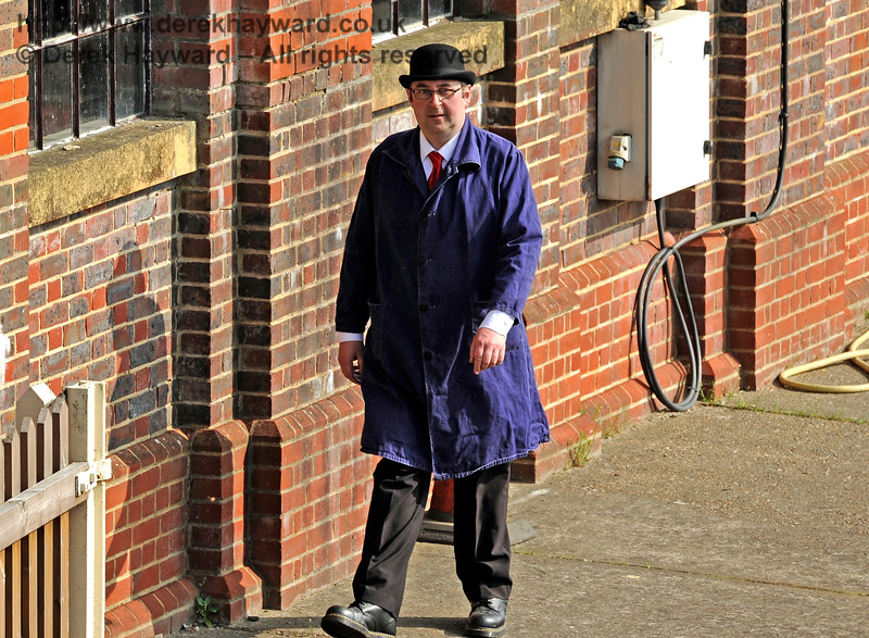 I always find it wise to avoid men in bowler hats because they are terribly important.  Neil Glaskin emerges from Sheffield Park shed. 06.04.2015 10639