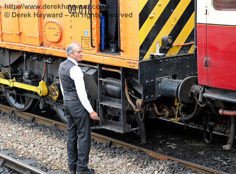 Graham Aitken contemplating the awful prospect of an orange diesel hauling a train.  Sheffield Park 24.09.2016 13971