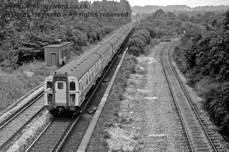 Copyhold Junction looking north on Sunday 9 August 1970 as 7326 passes with a Down train.  The line to Ardingly curves away on the right.  Eric Kemp retains all right to this image.