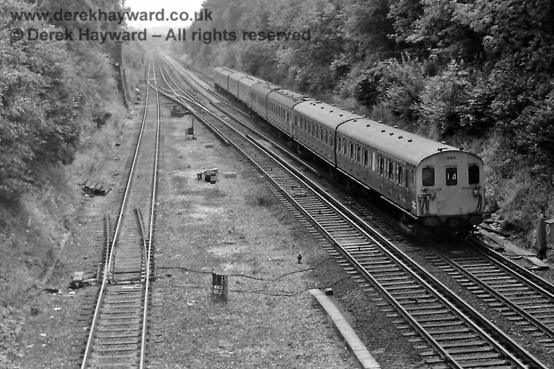 Copyhold Junction looking south on Sunday 9 August 1970 as 2-HAP 6104 passes at the head of an Up train.  On the left is the line from Ardingly with a very obvious set of trap points protecting the exit from the branch.  The track layout was subsequently changed with the points in the foreground removed and the goods line extended much further south.  Eric Kemp retains all right to this image.