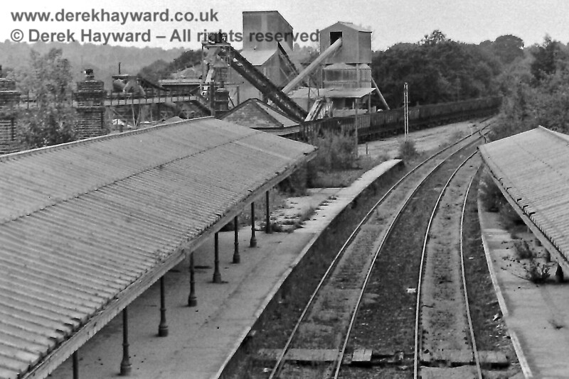 Five years later Eric Kemp's photo of Ardingly Station looking west on 9 August 1970 captures the surviving station platforms (and canopies), and also provides a nice vista of the industrial buildings then on site. The conductor rail had by then been lifted but the yard is full of wagons.  Eric Kemp retains all rights to this image.