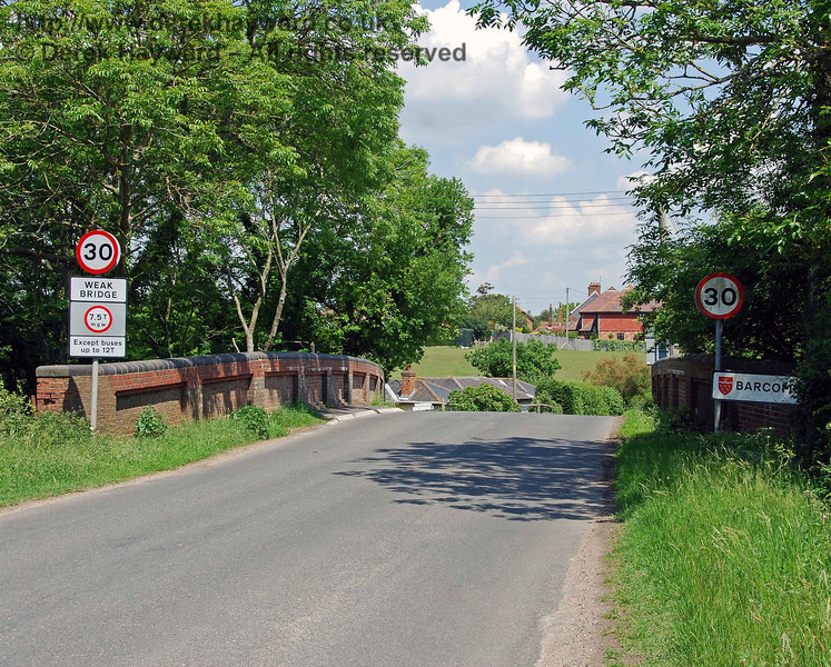 As is often the case with cross country lines, Barcombe Station is not in the village of Barcombe, and is actually at Barcombe Cross.  This view of the bridge  south of the station looks east.  02.06.2007