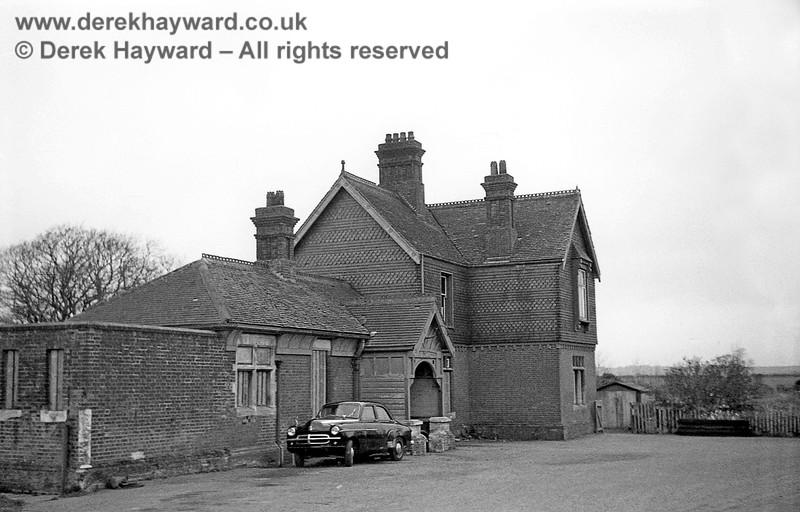 Barcombe Station looking north across the forecourt on 12 April 1965.   Note that many of the station windows and the porch were then boarded up.  John Attfield retains all rights to this image.