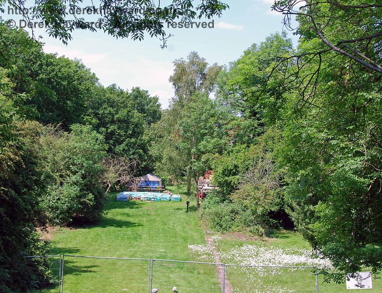 The much photographed view north along the trackbed through Barcombe Station, from the bridge, taken in 2007 when the building was hidden by trees.  02.06.2007