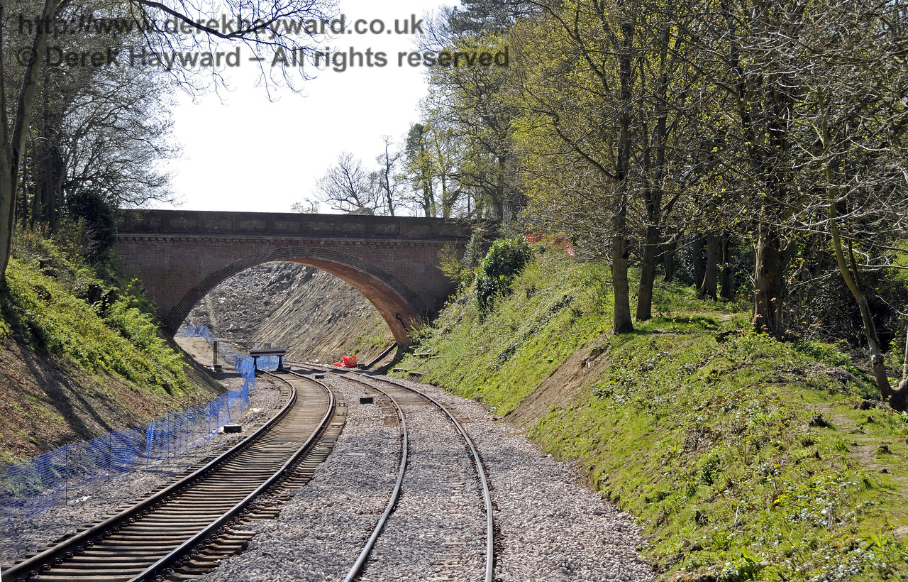 In April 2011, with the track in place, a succession of images taken moving slowly north away from Hill Place Farm Bridge.  The track on the left is a temporary siding that was subsequently removed.  10.04.2011  6725