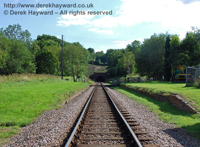 West Hoathly station was comprehensively demolished when the line closed, but the grass ramps either side of the picture mark the start of the platforms.  This view looks south, with the tunnel in the distance.  The footpath crosses the line about half way down the platforms. 27.08.2007