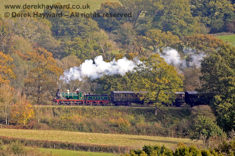 65 with a northbound train on the embankment leading towards Horsted House Farm.  24.10.2018 16848