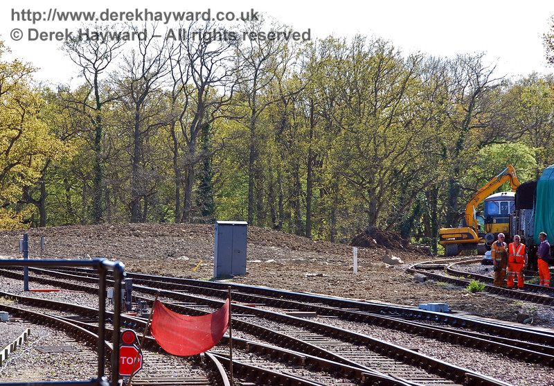 A much later photo from 29.04.2009, looking south from Horsted Keynes station shows spoil being unloaded into the triangle, which, by that stage, was almost full.