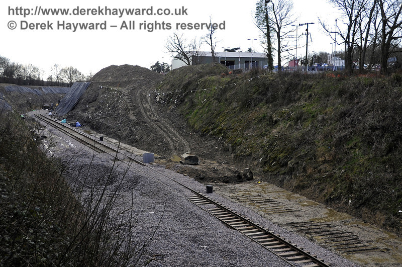 Now in 2013, looking south from Hill Place Farm Bridge, with the track laid in the northern part of the new cutting but not yet quite joined up with the track leading north to Imberhorne Lane Bridge.  A pile of additional ballast is on the left.  17.02.2013  6155