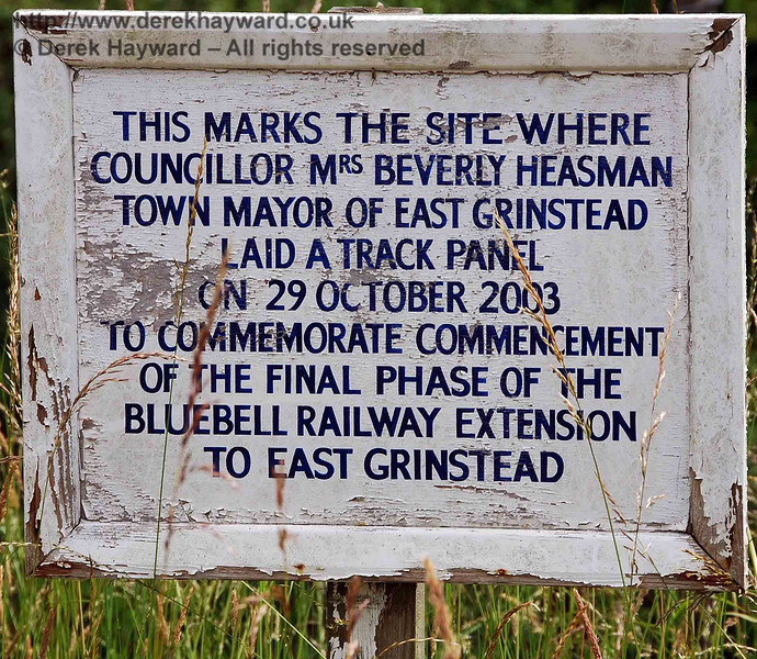 A sign marking the start of the East Grinstead extension on 29 October 2003 was originated located on a post near Vowels Lane Bridge. Unfortunately the sign has suffered slightly from the weather and it's rather exposed position. 28.06.2009.