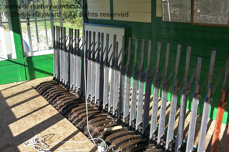 An old view, dating from 20.09.1998, of the lever frame then fitted inside Kingscote signal box.  Note that the levers were then unpainted.