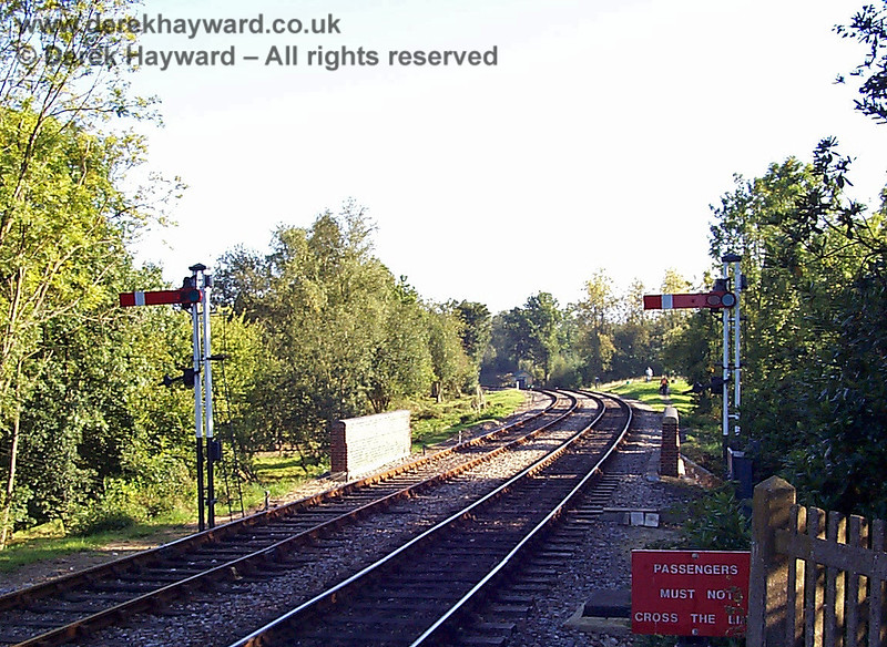 This low resolution view looks south from Kingscote Platform 1 on 20.09.1998.  In the distance the former Kingscote southern signalbox can just be seen and photographers are on the mound outside the station.  The path across the bridge has since been improved.