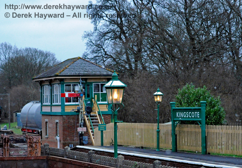 Almost the same view at dusk, with the station lamps shining in front of Kingscote signal box.  12.12.2015 12545