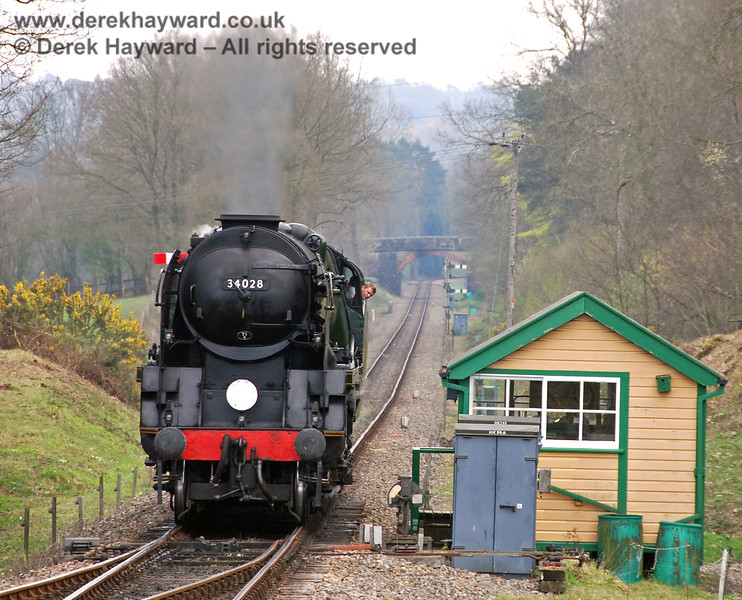 A ground signal adjacent to the former signal box controls movements into Kingscote.  The driver of 34028 Eddystone looks out to check the signal whilst running round his train. 09.04.2007
