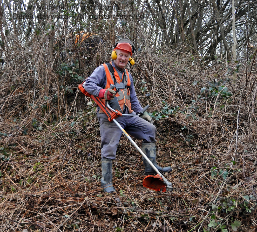 Eddie, one of a dedicated band of Friends of Kingscote, maintaining the lineside near the station.  13.02.2010  0520
