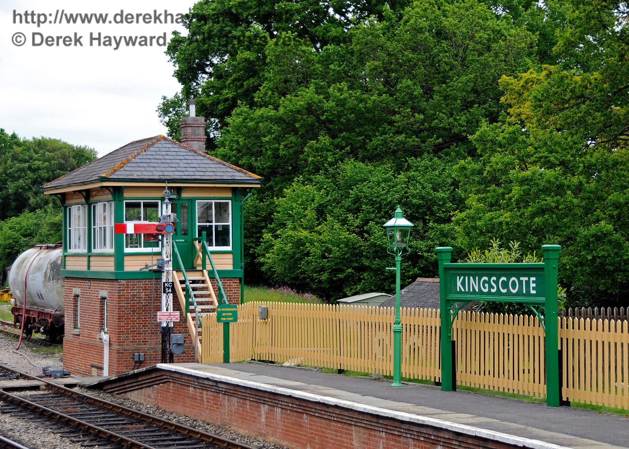 A general view of the northern end of Platform 2, including the northern signal box, Platform 2 starter and southbound running-in board.  09.06.2013  8933