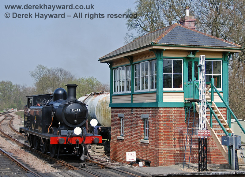 Kingscote northern signal box out of use in 2007.   32473 passes the box whilst running round on 14.04.2007  The signal box was brought into use in 2016 and has a separate large gallery.  Follow the link at the top of the page.
