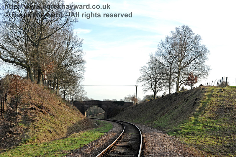 By 2011 the improvement in the quality of the lineside clearance is very obvious.  Looking south towards Caseford Bridge. 24.02.2011 0182