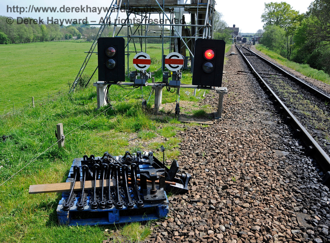 "In 2017 temporary colour light signals and ""calling on"" signals were installed whilst the bracket signal was refurbished.  Some of the new (or refurbished) parts are seen at ground level before fitting.  06.05.2017 17109"