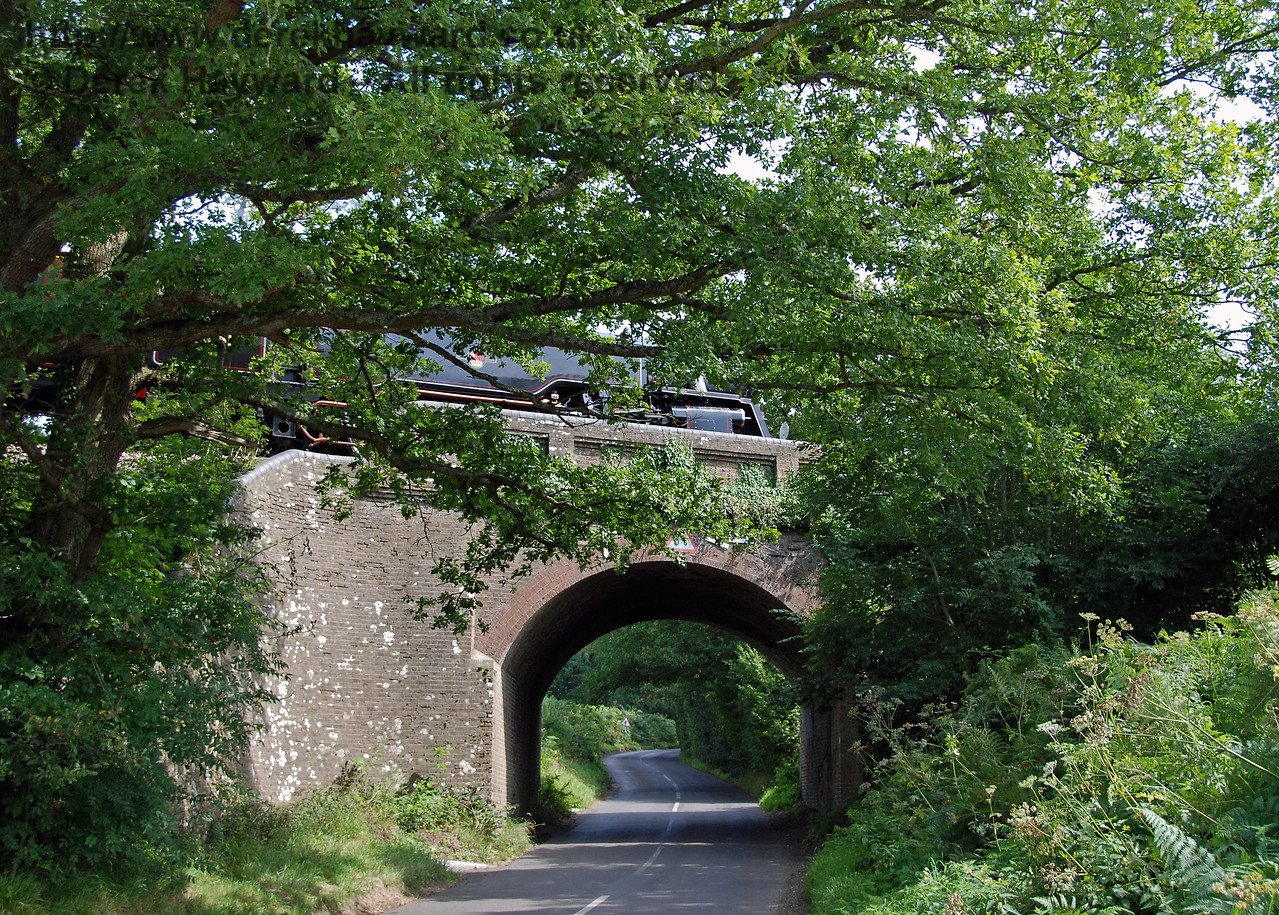 Hidden by the tree, 80151 rumbles over Monteswood Lane Bridge on 27.08.2007.  This view looks east.