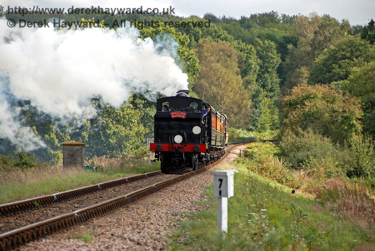 Having walked part of the way up Freshfield Bank, this view looks back south towards the Fogman's Hut, which marks the original position of the Sheffield Park Distant signal. 32473 approaches with a Grandparent's Special. Anyone for a cream tea? 23.09.2007
