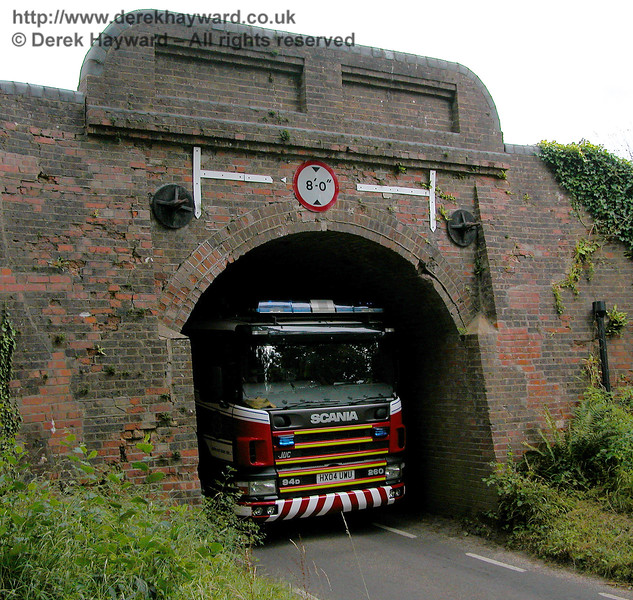 New Road Bridge is rather restricted in size.  It is better not to enquire why this rather large Fire Engine is included in this picture of the western side of the arch....  Whilst the driver was, err, extracting himself from a difficult position, 75027 was pressed into service and conveyed the crew to a lineside fire. 29.07.2006