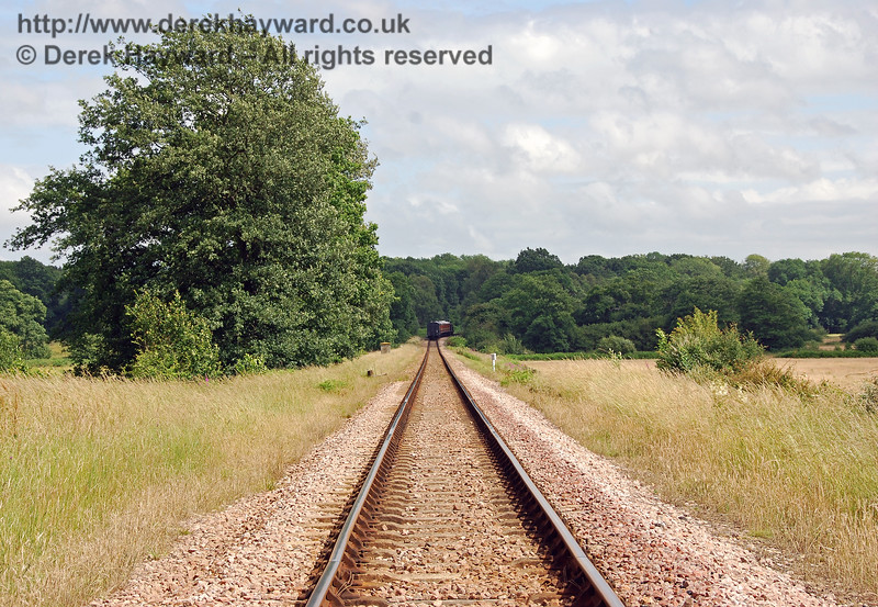 This shot looks south down Freshfield Bank from a point adjacent to the Distant signal.  In the far distance Fenchurch disappears around the bend towards Ketches Halt with the Victorian coaches. 01.07.2007