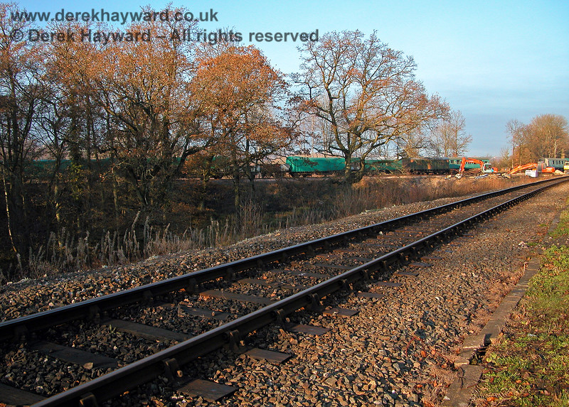 A view of the approach to Horsted Keynes in 2005.  In the distance some work appears to be taking place adjacent to the Ardingly Spur, but, at the time, the triangle appears to be empty of spoil. 11.12.2005