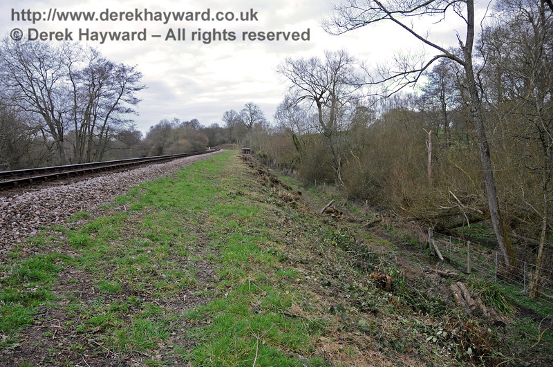 Turning round at the same location, this view looks north after lineside clearance.   In the distance is one of many PWay huts.  09.03.2011 6193