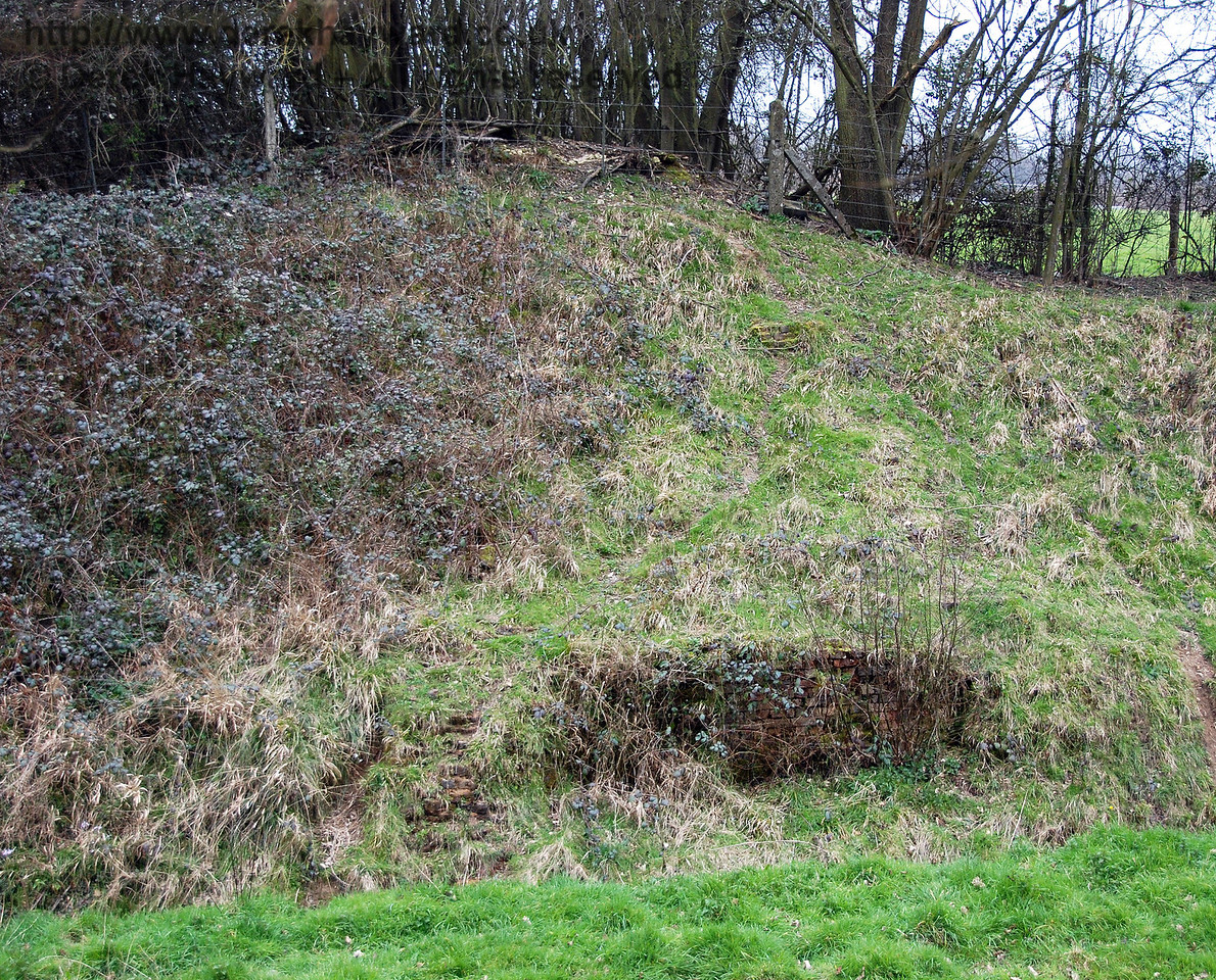 On the eastern side of the line there is also a mound in the embankment, and a small part of the bridge brickwork remains to mark the spot. 25.03.2007