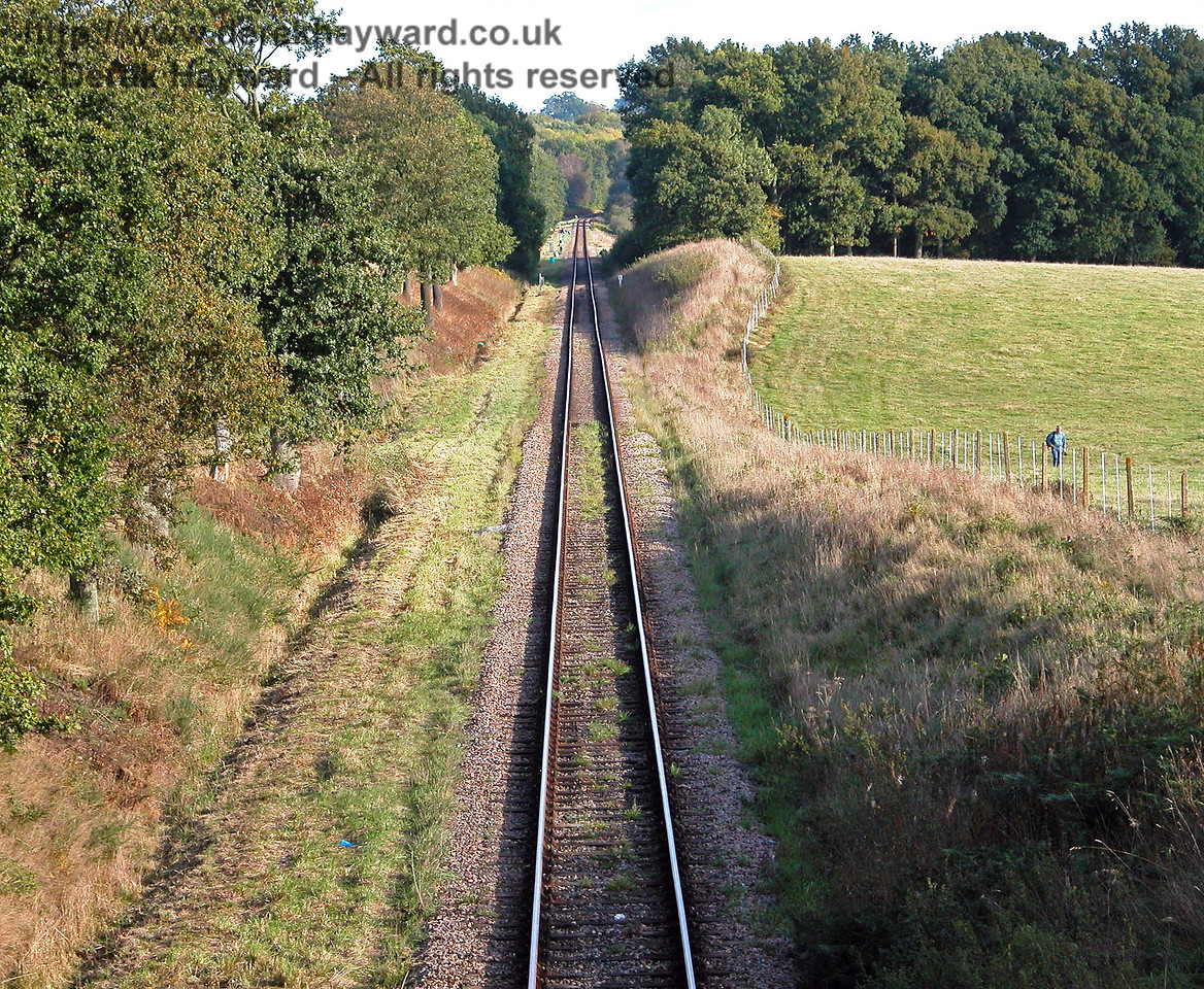Further north up Freshfield Bank, Town Place Bridge carries a farm track and a public footpath over the railway.  This view looks south towards the Distant signal from the bridge. 09.10.2005