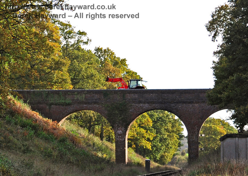 Many people think that Three Arch Bridge is simply a scenic part of the line, but it carries a public footpath and an agricultural crossing.  In October 2015 the light was fading fast, and I had just finished for the night, when the farmer obligingly went across on his tractor.   25.10.2015 12319
