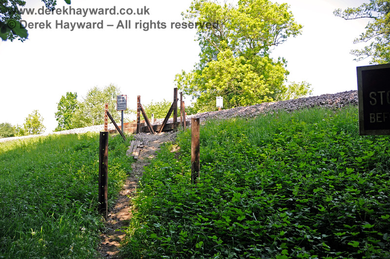 The western side of Tremains foot crossing looking east up the very steep slope towards the railway.  New posts had been installed but at the time the photo was taken they had yet to receive new fencing.  It is not known whether there are any plans to cut steps into this slope. 20.05.2018 18375
