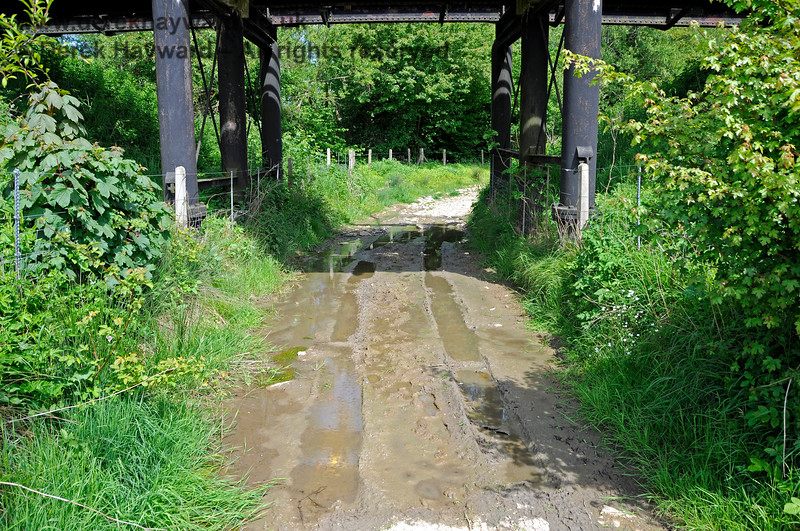 In winter Poleay Bridge acts as a flood relief channel for the nearby River Ouse Bridge.  As the water table is virtually on the surface at this point the farm track beneath the bridge is almost permanently waterlogged.  This view looks east.  18.05.2018 18297