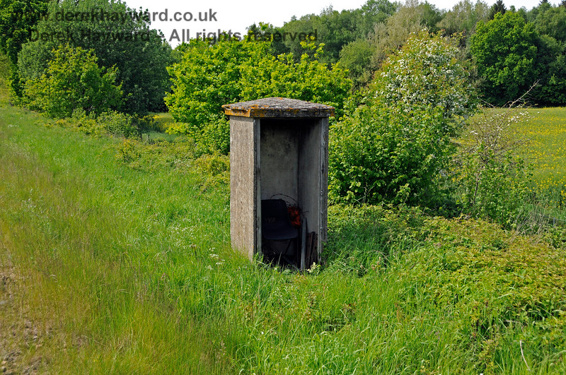 An old fog man's hut on Freshfield Bank.  These huts were originally sited near signals and provided shelter for men whose duty it was to place detonators on the track and to show flags or lamps to drivers in order to give information about the aspect of the signal in foggy conditions.  Such activities are now very much a relic of the past.  18.05.2018 18318