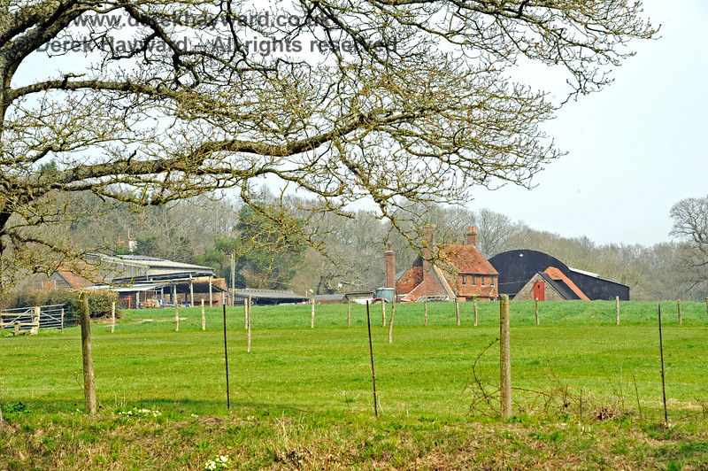 This is Little Oddynes Farm, on the eastern side of the line near Three Arch Bridge.  The old agricultural crossing previously pictured (now closed) linked it's land to Nobles Farm on the western side, but the same function is performed by Three Arch Bridge.  10.04.2015 10692