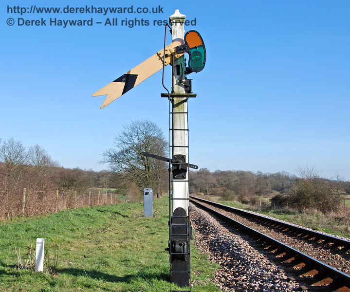 The Sheffield Park Outer Home signal is situated around the bend at the bottom of Freshfield Bank.  A Distant signal sited on the bank gives drivers early warning of the possible need to stop.  The signal is shown in the Off position on 11.03.2007