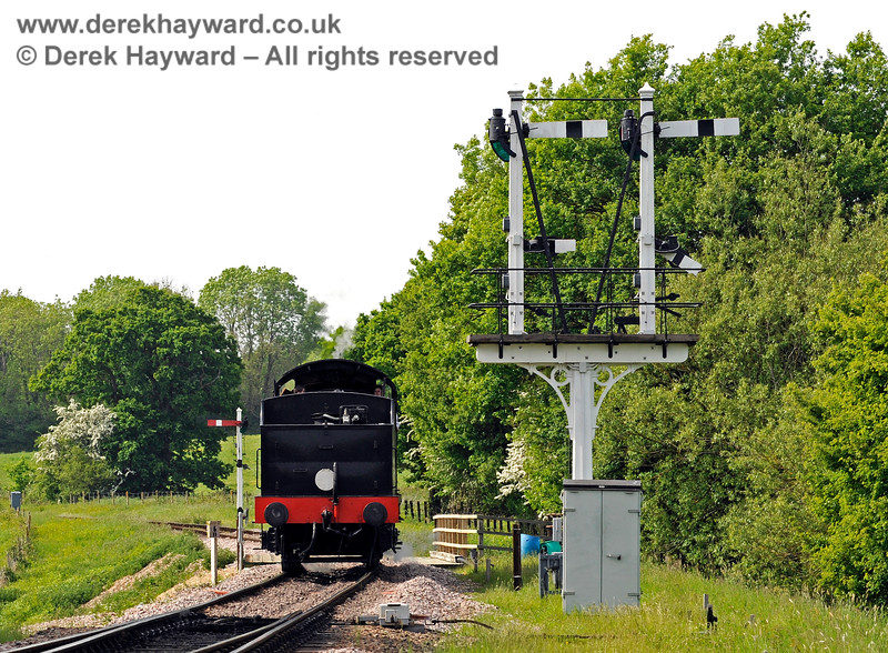 "The newly refurbished inner Home bracket signal at Sheffield Park, viewed from the rear.  the ""Calling On"" arm is ""Off"" to allow the locomotive to run round on to stock waiting in Platform 1.  the locomotive only needs to shunt beyond the signal to undertake this move, but in the distance the Advance Starter protects the remainder of the line.  This allows an incoming train to proceed up to the Outer Home (at Ketches Halt) whilst shunting is in progress at the station.  18.05.2018 16502"