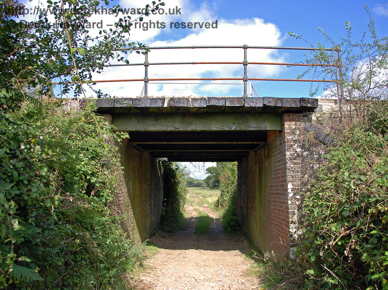 The first bridge up Freshfield Bank is Palmers Cattle Creep, a simple bridge of brick abutments crossed by iron girders, on which sits a timber base for the line.  This view looks east. 23.09.2007