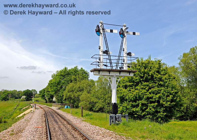 The newly refurbished Inner Home bracket signal at Sheffield Park, viewed from the rear.  In the distance is the northbound Advance Starter in it's new shortened condition.  The picture also catches the refurbished Poleay Bridge and some new track. 18.05.2018 18304