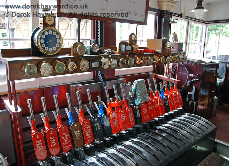 Sheffield Park originally had a lever frame on Platform 1, but this was enclosed inside a signal cabin to avoid the signalman being interrupted by visitors at inappropriate times.  This is the lever frame inside the box on 08.05.2007.  Also shown (top left) is the Walker's Train Describer which allows the locomotive shed to send requests for train moves to the signalman.