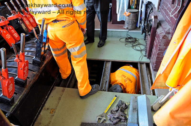 S&T working in the bowels of the box that you do not normally see.  Like all lever frames there is a lot under the floor, but it is not wise to interrupt them, especially when they have large spanners to hand....  10.03.2012 3829