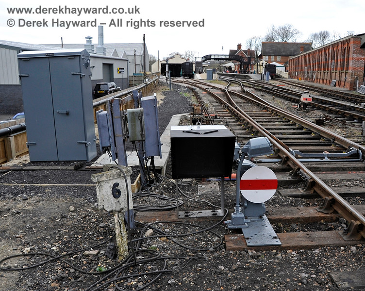 In 2012 new ground signals were installed for movements to and from the Carriage Shed.  In the background one of the original ground signals that controls movements from the south can also be seen.   20.03.2012 3892