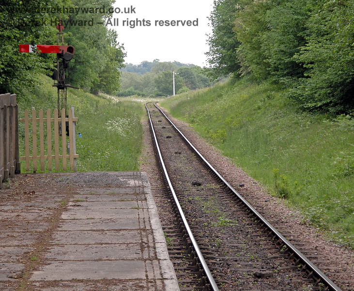 Another view of the signal from the platform of Ketches Halt also catches the northbound Advance Starter in the distance. 04.06.2006