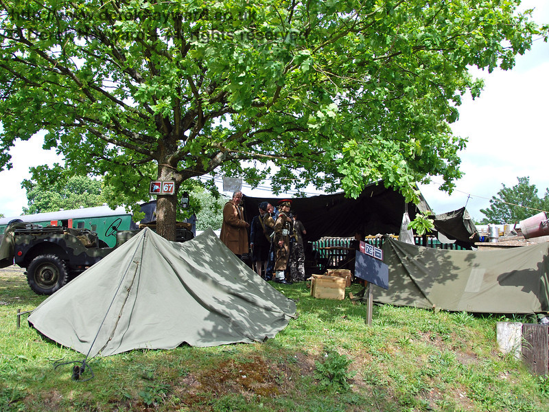 A tree hides the tents at Kingscote. 12.05.2007