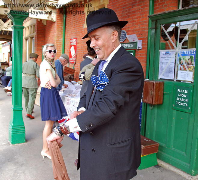 Viv the Spiv checks his supply of nylons and watches. Horsted Keynes. 10.05.2009